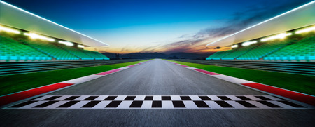Motion blurred racetrack with start or end line . Horizontal format .Night scene . 写真素材