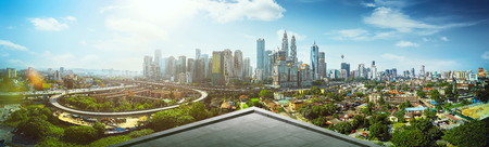 Open space balcony with Kuala Lumpur cityscape skyline view .