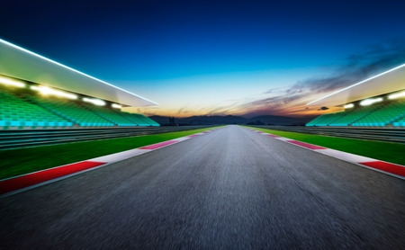 View of the infinity empty asphalt international race track .Night scene . Stok Fotoğraf
