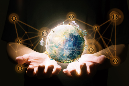 Closeup hand holding virtual earth with blockchain network connection . Electronic money ,blockchain transfers and finance concept.