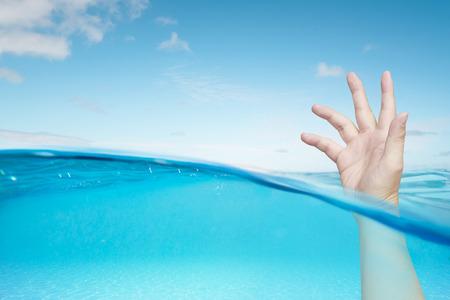 Waiting help hand in the water 版權商用圖片
