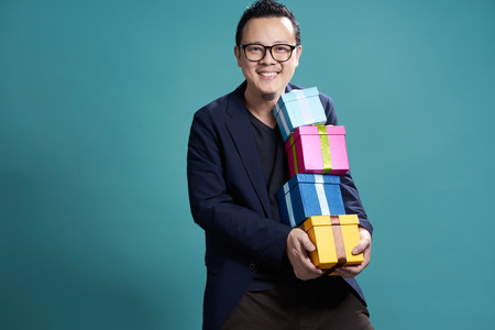 Businessman hold the present box to give somebody , holiday and christmas gift concept .