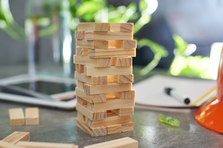 Brown wood building block tower with blur background .Selected focusing .