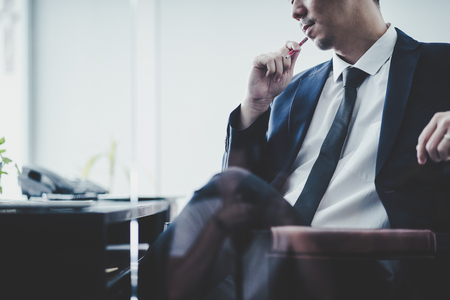 Businessman thinking Ideas sitting at his desk in a office . Imagens