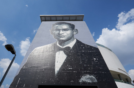 BANGKOK - THAILAND DEC 5, 2018 : Painting of Majesty King Bhumibol portrait at the wall in Bangkok, Thailand.  Bangkok is also the most populated city in Thailand .