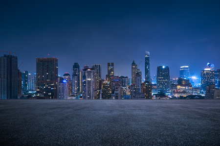 Bangkok urban cityscape skyline night scene with empty asphalt floor on front Stock fotó
