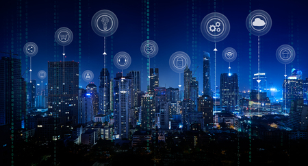 Smart city with smart services and icons, internet of things, networks and augmented reality concept ,Bangkok city night scene.