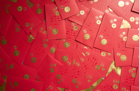 Red packet background , Chinese new year wish concept . Archivio Fotografico - 115372600