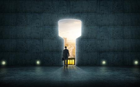 Hesitant businessman stand on wall with digital usb key hole door ,sunrise scene city skyline outdoor view . 免版税图像