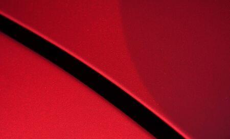 Cerrar detalle de la carrocería de revestimiento de pintura metálica roja Foto de archivo