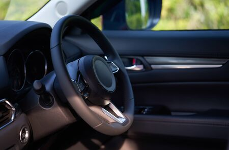 Vehicle interior of a modern car with steering wheel