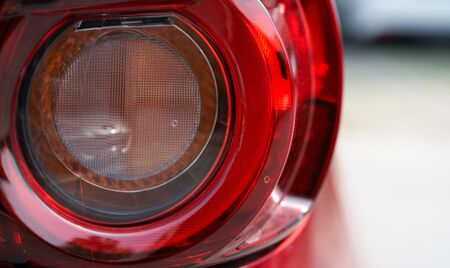 Close up detail of the rear tail light of a red car
