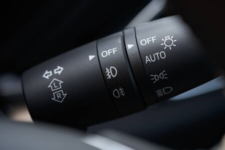 Vehicle interior of a modern car with light control switch 免版税图像