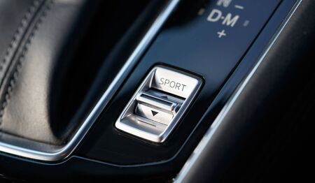 Vehicle interior of a modern car with sport mode button