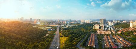 Panorama wide angle view cityscape,green park,terrace house and highway located at Kuala Lumpur,Malaysia .