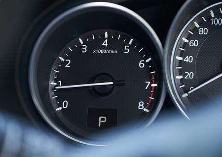 Closeup of a modern car interior with RPM speedometer