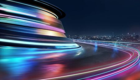 Abstract motion curvy urban road with neon light motion effect applied . Automobile background use concept .