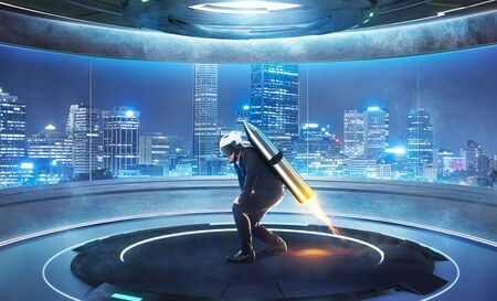 Businessman ready to fly with jetpack in futuristic round shape interior design room with modern cityscape view from big glass window . Startup Business concept .