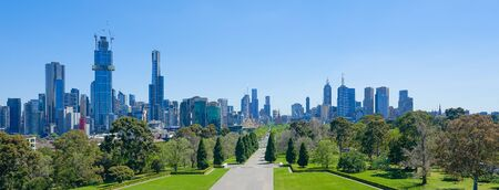 Melbourne cityscape panorama view from Shrine of Remembrance on a sunny day .