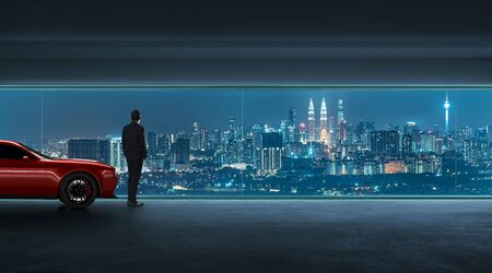 Successful businessman looking the city from his garage with luxury car, night scene .
