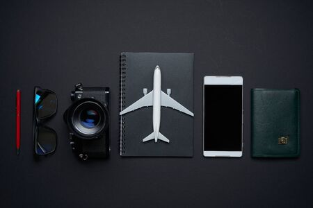 Outfit ,accessories and equipment of traveler on black background with copy space .travel concept . Imagens