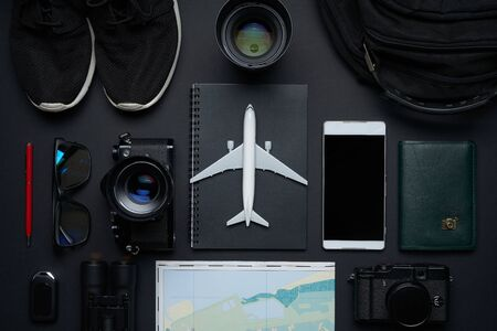 Outfit ,accessories and equipment of traveler on black background with copy space . Travel concept . Imagens