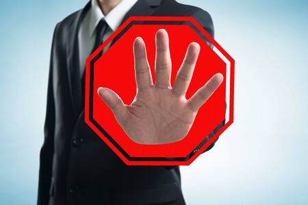 Businessman hand with stop figure and icon.