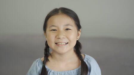 Beautiful smile asian little girl portrait, close up Imagens