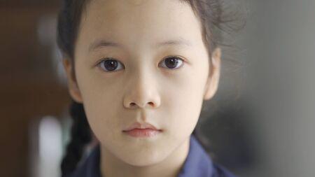 Beautiful asian little girl portrait, close up Imagens