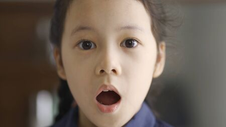 Asian little girl scared expression, close up