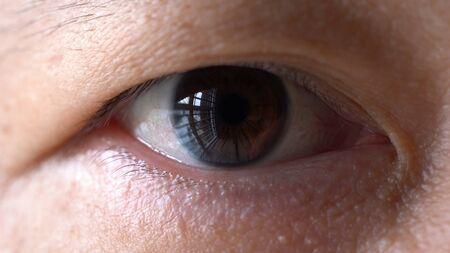 Super macro shot of asian men eye Imagens