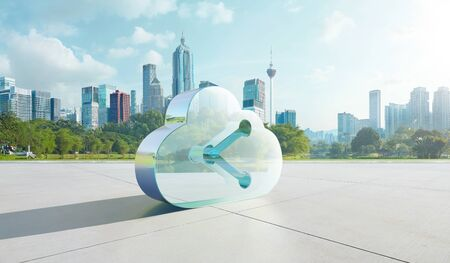 Transparent glass symbol of cloud with data share icon on floor with green city background. Mixed media