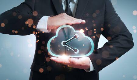 Businessman holding transparent digital cloud storage icon Imagens