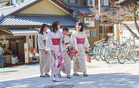 Kyoto,Japan - 28 March,2015 : Visitor wearing traditional Japanese kimono walking in Kyoto outskirt Editorial