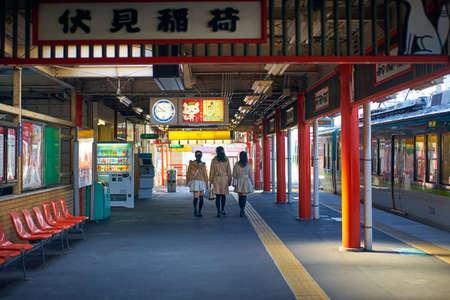 Kyoto,Japan - 27 March,2015 : People take the train to visit Fushimi-Inari Taisha shrine torii gates in Japan. Editorial