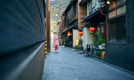 Kyoto,Japan - 27 March,2015 : Maiko geisha walk on the street of Gion, Kyoto old town, Japan. Editorial