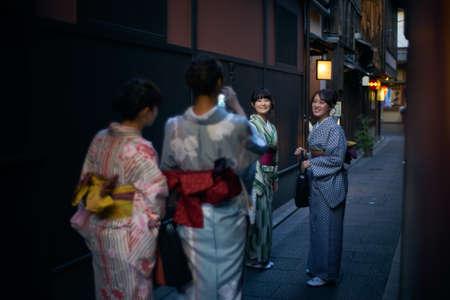 Kyoto,Japan - 27 March,2015 : Visitor wearing traditional Japanese kimono take photographs on Kyoto outskirt