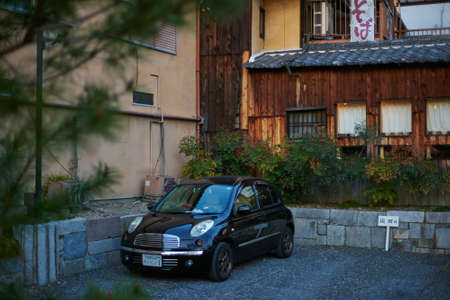 Kyoto,Japan - 27 March,2015 : Kyoto cute Japanese car parking  on the street of Kyoto old town, Japan. Editorial