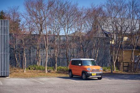 Karuizawa, Nagano, Japan - 30 March,2015 : Kyoto cute Japanese orange color car parking  on the street of Karuizawa, Japan. Editorial