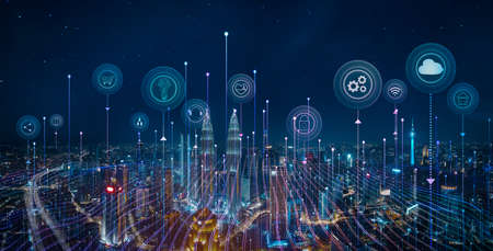 Panorama aerial view in the cityscape skyline with smart services and icons, internet of things, networks and augmented reality concept, night scene.