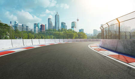 Racetrack with railing and city background, daytime scene. 3d rendering Standard-Bild