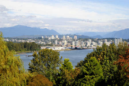fraser: Autumn View of the city by the river Stock Photo