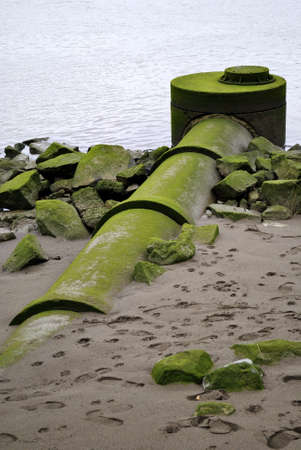 environment damage: drainpipe over the river