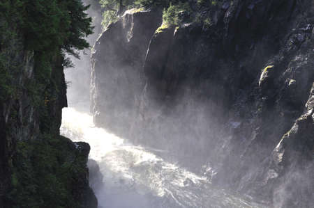 rapidly: water pouring down from the reservoir and passing through the canyon rapidly