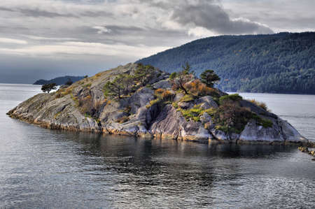 small rocky island on the sea photo
