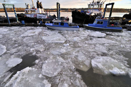surrounding: floating ice surrounding the pier Stock Photo