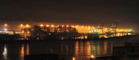 A harbor by Fraser River in a foggy night