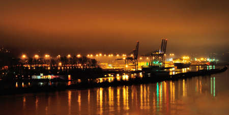 fraser river: A harbor by Fraser River at a foggy night Stock Photo