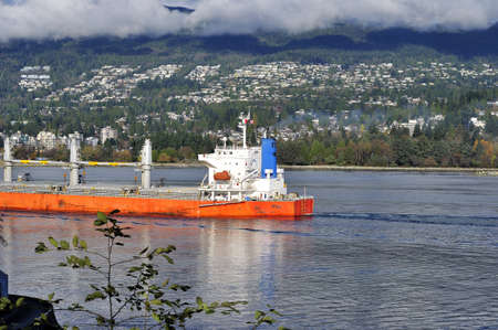 A ship leaving Burrard Inlet photo