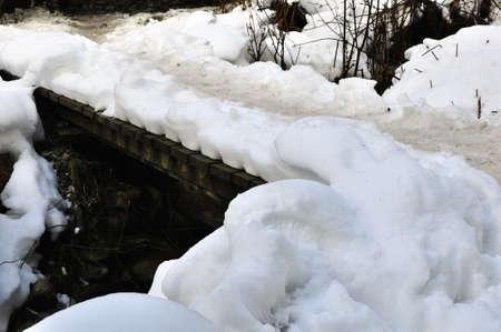 snow covered walking bridge on a mountain trail Stock Photo - 17169542